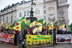 London, UK. 11 October, 2019. Kurdish supporters of the YPG protest in Piccadilly Circus against Turkey's ground invasion of Kurdish-held areas in northern Syria and to call for the UK to stop supporting the Turkish government. The latest UN reports suggest that 100,000 people have already fled their homes in Northern Syria as a result of the Turkish assault.