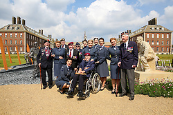 © Licensed to London News Pictures. 20/05/2019. London, UK. Normandy veterans dressed in their blazer, beret and medals with army army cadets poses for photograph on the 'D-Day 75 Garden', which is sitting on the 15 stone plinths on the path leading to the Royal Hospital Chelsea.  <br /> The Royal Horticultural Society Chelsea Flower Show is an annual garden show held over five days in the grounds of the Royal Hospital Chelsea in West London. The show is open to the public from 21 May until 25 May 2019. Photo credit: Dinendra Haria/LNP