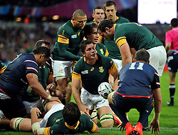Francois Louw of South Africa is congratulated on his first try of the match - Mandatory byline: Patrick Khachfe/JMP - 07966 386802 - 07/10/2015 - RUGBY UNION - The Stadium, Queen Elizabeth Olympic Park - London, England - South Africa v USA - Rugby World Cup 2015 Pool B.
