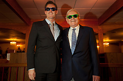 Warren Buffett poses with business students from universities around the country after at lunch at Piccolo Pete's Restaurant in Omaha, Neb., Nov. 11, 2011. Here, Buffett poses with Andrew Robertson, 27 years old, second-year M.B.A. student at the University of Toronto.