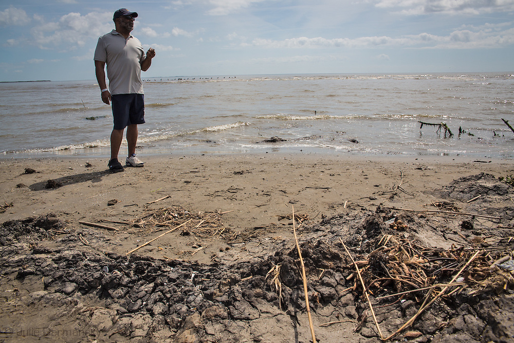 March 31, 2015,  Five years after the BP oil spill, a group led by National Wildlife Federation find a tar matt on East Grande Terre, a barrier island in Plaquemines Parish that was hit hard by the BP oil spill in 2010.<br /> BP recently led an effort to clean up a tar mat uncovered on the same area of the beach a couple weeks before that was connected to the BP oil spill.