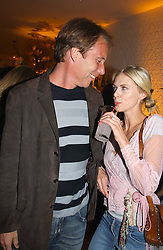 DAMIAN ASPINALL and DONNA AIRat a party to celebrate the opeing of the new Paul & Joe Boutique at 134 Sloane Street, London SW1 on 14th April 2005.<br />