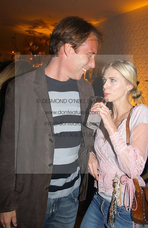 DAMIAN ASPINALL and DONNA AIRat a party to celebrate the opeing of the new Paul & Joe Boutique at 134 Sloane Street, London SW1 on 14th April 2005.<br /><br />NON EXCLUSIVE - WORLD RIGHTS