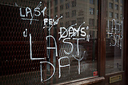 A closed shop still bears in its window the evidence of its last few days of business, on 1st August 2017, at Blackfriars, in London, England.