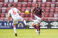 Hearts latest signing Loic Damour (#22) of Heart of Midlothian FC gets to the ball ahead of Ross Draper (#6) of Ross County FC during the Ladbrokes Scottish Premiership match between Heart of Midlothian and Ross County at Tynecastle Stadium, Edinburgh, Scotland on 10 August 2019.