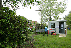 © Licensed to London News Pictures. 07/05/2015. Tamworth, Staffordshire, UK. Polling stations opened at 7 am on the day of the General Election. Pictured, The voting station in Buckingham Road, Tamworth, located in a field. Photo credit : Dave Warren/LNP
