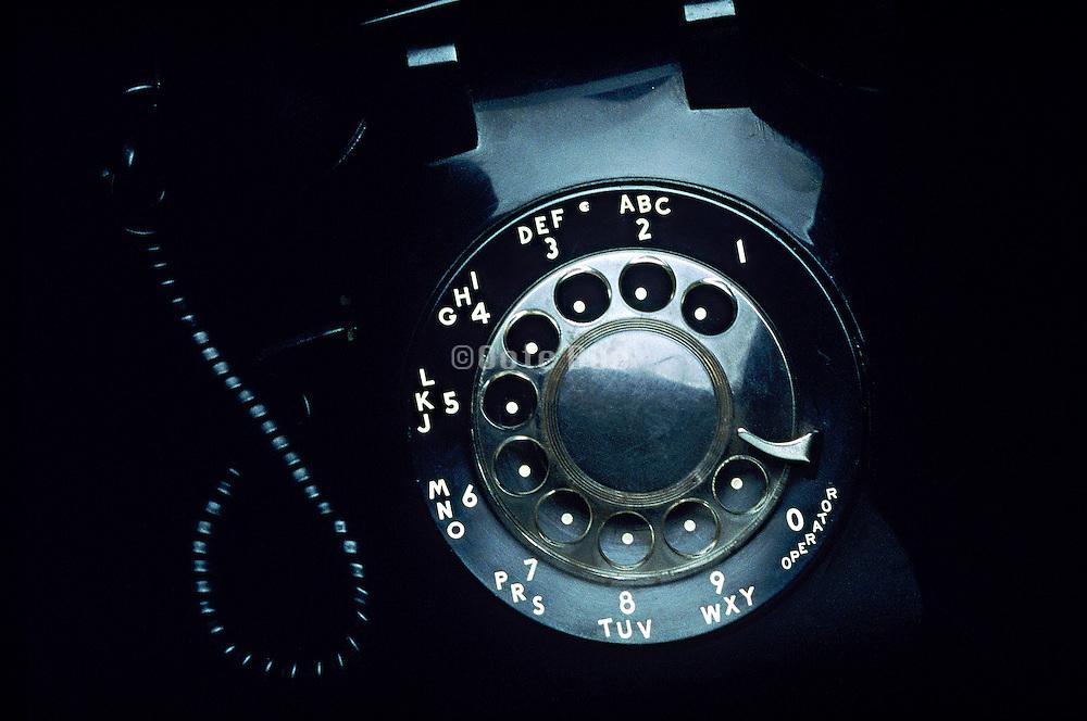 A black rotary telephone