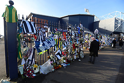 Tributes are placed on the gates during the memorial service for Cyrille Regis at The Hawthorns, West Bromwich.