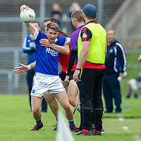 Cratloe's Cathal McInerney is held on the line by Clondegad's Gary Brennan