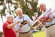 A Group of Senior Friends Enjoying a Model Airplane