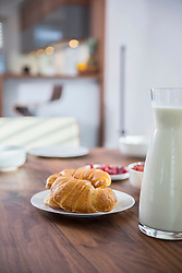 Croissants and milk for breakfast at dining table, Munich, Bavaria, Germany