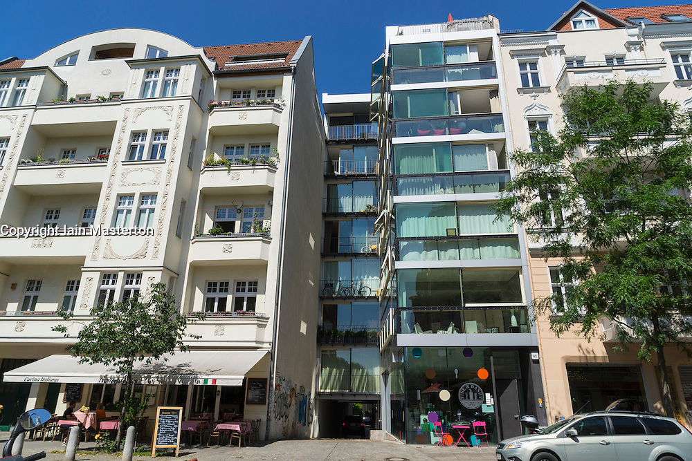 Contrasting exterior facades of old and new apartment buildings in Prenzlauer Berg district of Berlin Germany