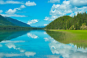 Coulds refflected in Muncho Lake. Northern Rocky Mountains<br />Muncho Lake Provincial Park<br />British Columbia<br />Canada