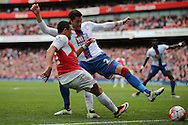 Alexis Sanchez of Arsenal has a cross blocked by Joel Ward of Crystal Palace. Barclays Premier league match, Arsenal v Crystal Palace at the Emirates Stadium in London on Sunday 17th April 2016.<br /> pic by John Patrick Fletcher, Andrew Orchard sports photography.