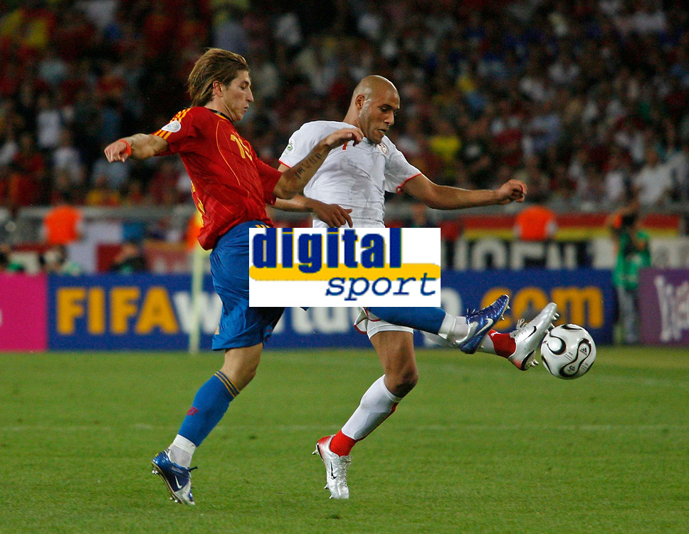 Photo: Glyn Thomas.<br />Spain v Tunisia. FIFA World Cup 2006. 19/06/2006.<br /> Spain's Sergio Ramos (L) and Tunisia's Adel Chedli.