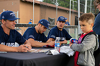 KELOWNA, CANADA - JUNE 28: Retired NHL player Wade Redden sits next to Stanley Cup champion Brayden Schenn and Luke Schenn during an autograph session prior to the opening charity game of the Home Base Slo-Pitch Tournament fundraiser for the Kelowna General Hospital Foundation JoeAnna's House on June 28, 2019 at Elk's Stadium in Kelowna, British Columbia, Canada.  (Photo by Marissa Baecker/Shoot the Breeze)