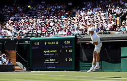 Kyle Edmund serves on day two of the Wimbledon Championships at the All England Lawn Tennis and Croquet Club, Wimbledon.