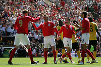 Photo: Paul Thomas.<br /> England v Jamaica. International Friendly. 03/06/2006.<br /> <br /> Peter Crouch (L) of England celebrates his goal with David Beckham, Joe Cole and Rio Ferdinand.
