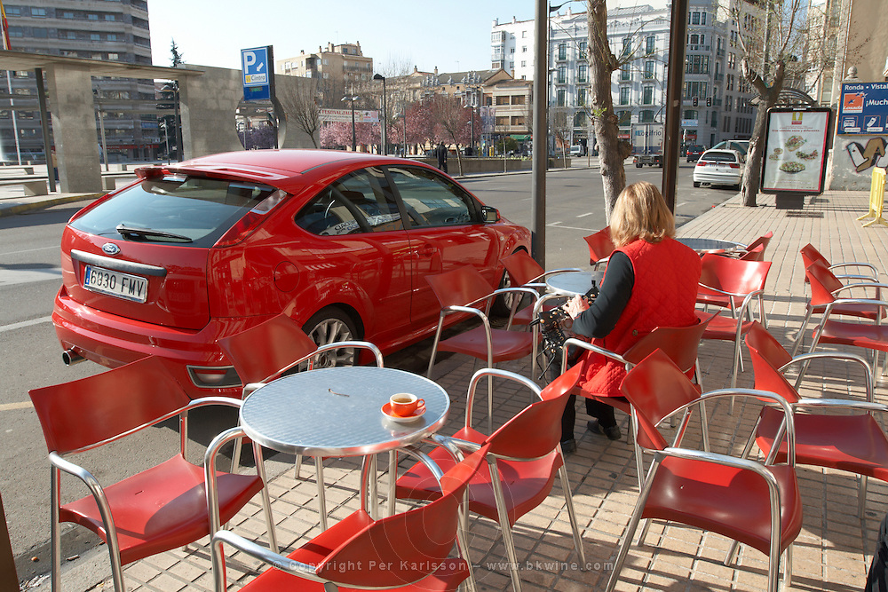 red car, chairs and woman drinking coffee restaurant terrace , Zamora spain castile and leon