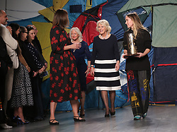(left to right) Chief Executive of the British Fashion Council, Caroline Rush, the Duchess of Cornwall and the winner of the Queen Elizabeth II Award for British Design, Bethany Williams, during the Autumn/Winter 2019 London Fashion Week show at the BFC Show Space, London.