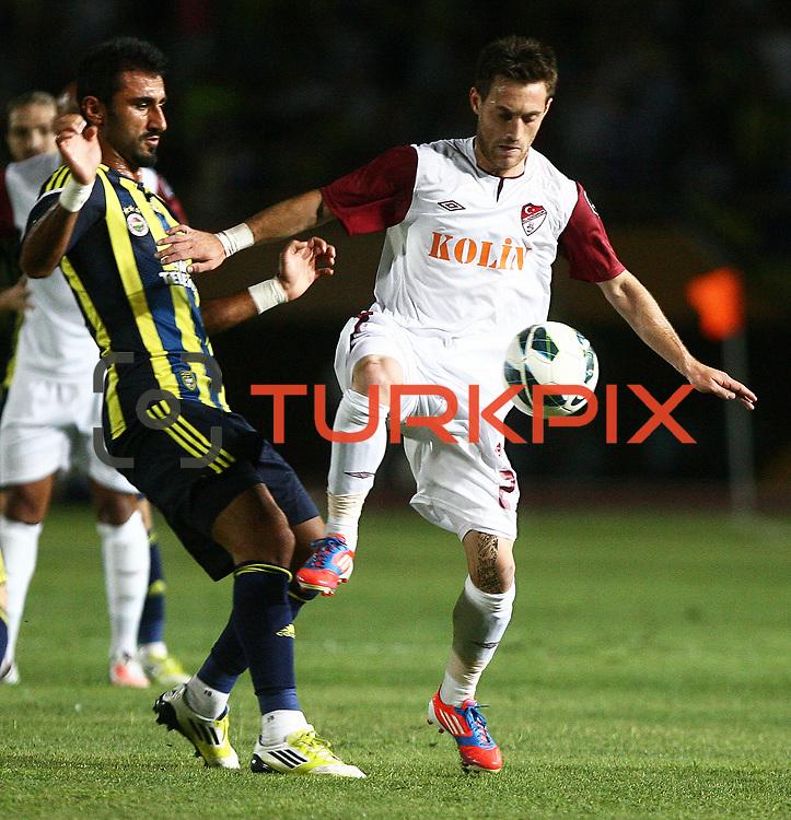 S.B. Elazigspor's and Fenerbahce's Selcuk Sahin (L) in action during their Turkish superleague soccer match S.B. Elazigspor between Fenerbahce at the Ataturk stadium in izmir Turkey on Saturday 18 August 2012. Photo by TURKPIX