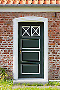 Painted door of traditional cottage house on Fano Island - Fanoe - South Jutland, Denmark