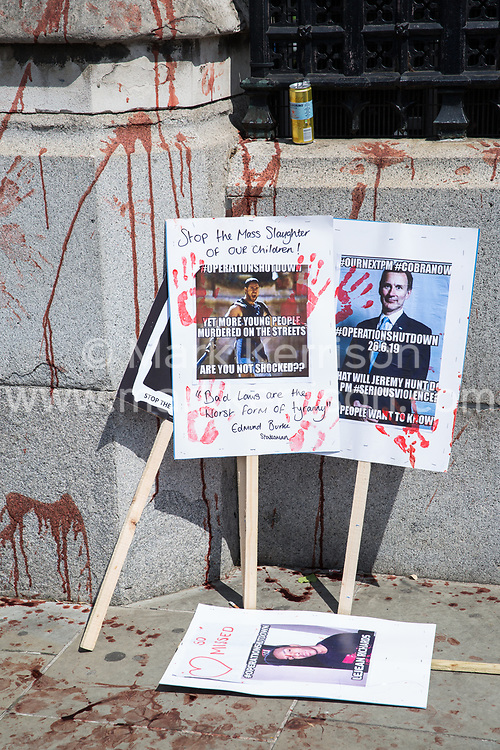 London, UK. 26 June, 2019. Placards and fake blood left by families and friends affected by knife crime protest outside Parliament as part of Operation Shutdown to put pressure on the Government, and in particular the next Prime Minister, to take urgent action to prevent knife crime and to protect its citizens.