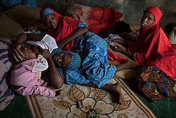 Aisha, 17, breast feeds her 8-month-old son Mohammed, born of a Boko Haram fighter, while visiting with her sisters Hassan and Hussaina. Five girls from their family were taken by the militant Islamist group, which began it's insurgency against the Nigerian government in 2009. The terrorist group drew global outrage after abducting more than 270 schoolgirls from the town of Chibok. Many of the girls were forced into marriage and motherhood. The Borno State National Emergency Agency estimates tens of thousands more women and girls have also been kidnapped by militants in less-publicized attacks. In armed conflicts, child marriage is increasingly used as a weapon of war, forcing girls to give birth give birth to the next germination of fighters. Thousands of girls remain missing in Nigeria with little help of rescue. Those who manage to escape struggle with little support to rebuild their lives.