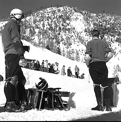 Riders wait for their skeletons at The Cresta Run, St.Moritz, Switzerland in January 1960.