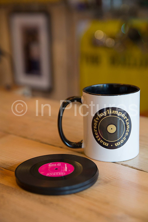 A mug and vinyl drinks coaster at Matters of Vinyl Importance cafe in Shoreditch on the 12th April 2018 in East London in the United Kingdom.