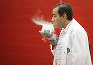 Middletown, New York - Erik Maldonado blows on a block of dry ice during a Mad Science demonstration at the YMCA summer camp on August 20, 2010.