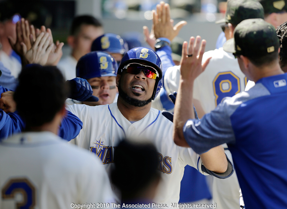 Seattle Mariners' Edwin Encarnacion in the dugout after hitting a home run against the Minnesota Twins during a baseball game, Sunday, May 19, 2019, in Seattle. (AP Photo/John Froschauer)
