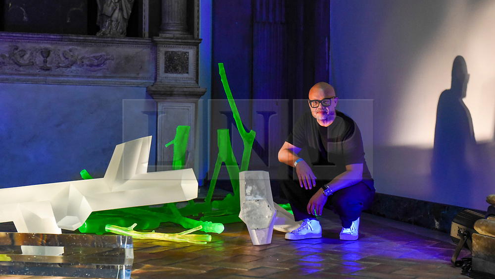 """© Licensed to London News Pictures. 13/09/2019. LONDON, UK. Designer Rony Plesl with his work """"Sacred Geometry"""" on display at the V&A museum as part of London Design Festival.  The festival, now in its 17th year, includes installations across the capital and runs 14 to 22 September 2019.  Photo credit: Stephen Chung/LNP"""