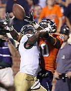 Virginia Cavaliers wide receiver Tim Smith (20) hauls in a pass under pressure from William & Mary Tribe cornerback B.W. Webb (2) during the second half of an ACC football game Saturday September 3, 2011 in Charlottesville, Va. Virginia won 40-3. (Photo/Andrew Shurtleff)