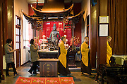 Buddhist monks and worshippers take part in funeral ceremony at the Jade Buddha Temple, Shanghai, China