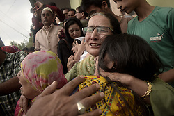 June 15, 2018 - Baramulla, kashmir, India - Kashmiri women comforts waling relatives of slain senior journalist Shujaat Bhukhari at his ancestral  hometown of  kreeri in North kashmir's Baramulla district of Indian-Administered-Kashmir on Friday, June 15, 2018.  Senior journalist and editor –in-chief of Kashmir's local English daily newspaper Rising Kashmir  Bukhari along with his  two personal security officers  were shot dead by unknown gunmen outside his office in press enclave, Srinagar on thurday evening ahead of Eid-ul-fitr. However, Lashkar-e-Toiba( militant group) has condemned the killing of Shujat Bukhari says it is a conspiracy hatched by Indian agencies to suppress the voice of indigenous freedom struggle. (Credit Image: © Sanna Irshad Mattoo via ZUMA Wire)