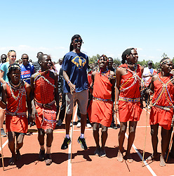© Licensed to London News Pictures. Iten, Kenya. MO FARAH with Masai Dancers as he opens the new London-Marathon-funded running track, which will be managed by the Lornah Kiplagat Sports Academy.  Double world and Olympic champion MO FARAH in training at an altitude training camp based at 2,500m in Iten, Kenya, ahead of the 2014 Virgin Money London Marathon in April this year. The Somalia born, adopted Brit, is looking to make the jump from the 10,000m distance to a full marathon for the first time in front of a home crowd. Photo credit : Mike King/LNP
