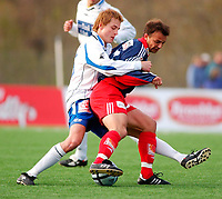 Fotball 1 divisjon/230504/Tromsdalen/Tromsdalen (TUIL)- FK Haugesund 3-1/ TUILs Bård Karlsen  og Haugesunds Ronny Warholm<br /> FOTO: KAJA BAARDSEN/DIGITALSPORT