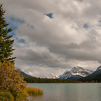 Mountains of the Canadian Rockies rise behind Waterfowl Lake.