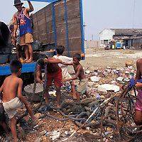 Philippines, Luzon Island, Scavengers pick through trash at squatter camp by Navotas Fishing Port in Manila