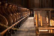 Interior of Narbonne Cathedral showing pews for the choir in Narbonne, France. Cathedrale Saint-Just-et-Saint-Pasteur de Narbonne, is a Gothic style Roman Catholic church located in the town of Narbonne, France. The cathedral is a national monument and dedicated to Saints Justus and Pastor.