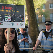 Hundreds of protestors, protests of the massacre of Palestinian protestor in Gaza by the Israelis army on the day US moving its embassy to Jerusalem outside Downing Street on 15 May 2018, London, UK.