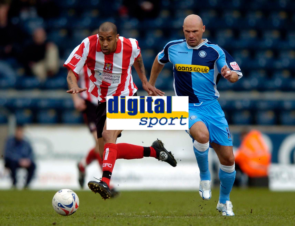 Photo: Richard Lane.<br />Wycombe Wanderers v Lincoln City. Coca Cola League 2. 17/04/2006. <br />Lincoln's Francis Green breaks from Wycombe's Tommy Mooney.