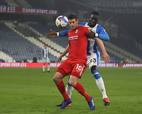 Huddersfield Town's Mouhamadou Naby Sarr in action with  Birmingham City's Lukas Jutkiewicz<br /> <br /> Photographer Mick Walker/CameraSport<br /> <br /> The EFL Sky Bet Championship - Huddersfield Town v Birmingham City - Tuesday 2nd March 2021 - The John Smith's Stadium - Huddersfield<br /> <br /> World Copyright © 2020 CameraSport. All rights reserved. 43 Linden Ave. Countesthorpe. Leicester. England. LE8 5PG - Tel: +44 (0) 116 277 4147 - admin@camerasport.com - www.camerasport.com