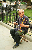 Chinese Violin and Violinist in the park by Houhai Lake. Hutong life refers not only to the alleyways and courtyards of Beijing, but mostly to the neighborly way of life that is said to be disappearing.