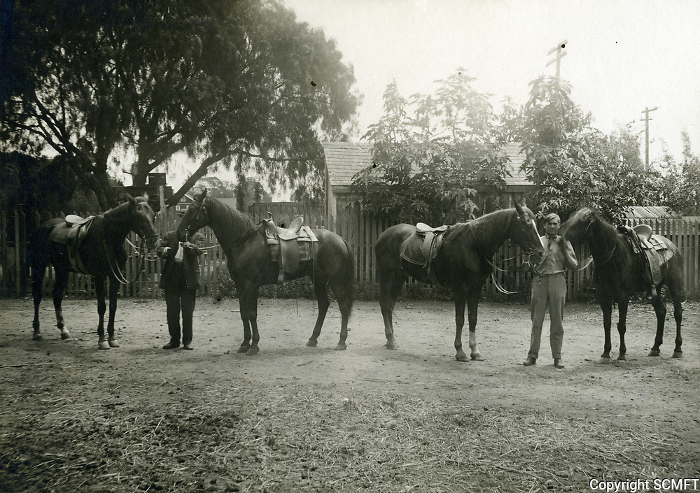 1910 Horses and riders at the rear of the Sunset Livery Stable on Sunset Blvd., just west of Cahuenga Ave