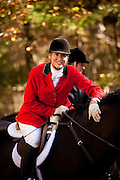 A women fox hunter at the Middleton Place Fox Hunt during a break in the hunt at Middleton Place plantation in Charleston, SC. The hunt is a drag hunt where a scented cloth is used instead of live fox.