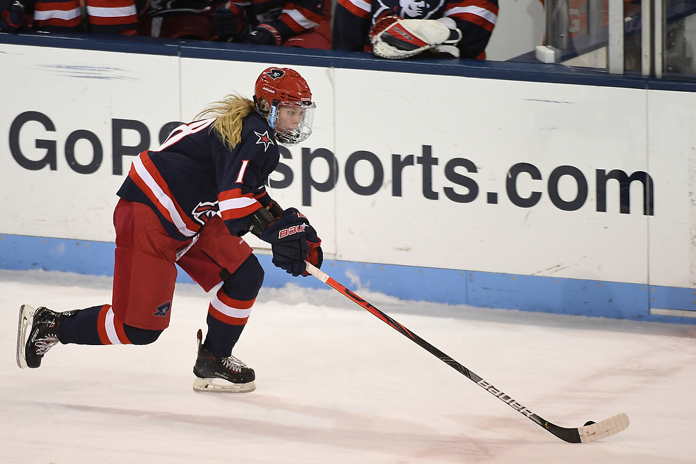 STATE COLLEGE, PA - FEBRUARY 05: Mackenzie Krasowski #18 of the Robert Morris Colonials skates with the puck in the first period during the game against the Penn State Nittany Lions at the Pegula Ice Arena on February 5, 2021 in State College, Pennsylvania. (Photo by Justin Berl/Robert Morris Athletics)