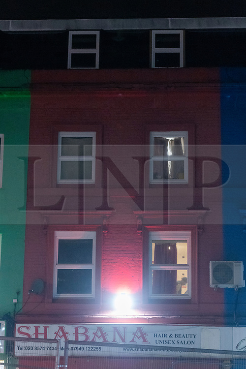 © Licensed to London News Pictures. 19/12/2020. London, UK. The red building in The Crescent in Southall where a body has been discovered. Neighbours had reported a a smelling odour for the last couple of weeks from the building. Photo credit: Ray Tang/LNP