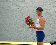 Shunyi, CHINA. GBR M4- Peter REED,  and looks at his gold medal  after the medal ceremony,  Olympic Regatta, Shunyi Rowing Course.  Sunday  17/08/2008  [Mandatory Credit:  Svend Aage Nielsen/  Intersport Images]